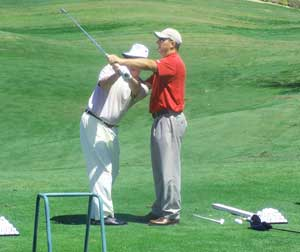 Derek Nannen instructs a student at the Eagle Mountain Golf Academy